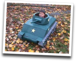 kid in a toy tank