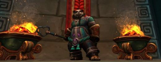 A pandaren monk by a few brasiers